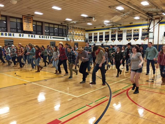Students square dance for a cause.