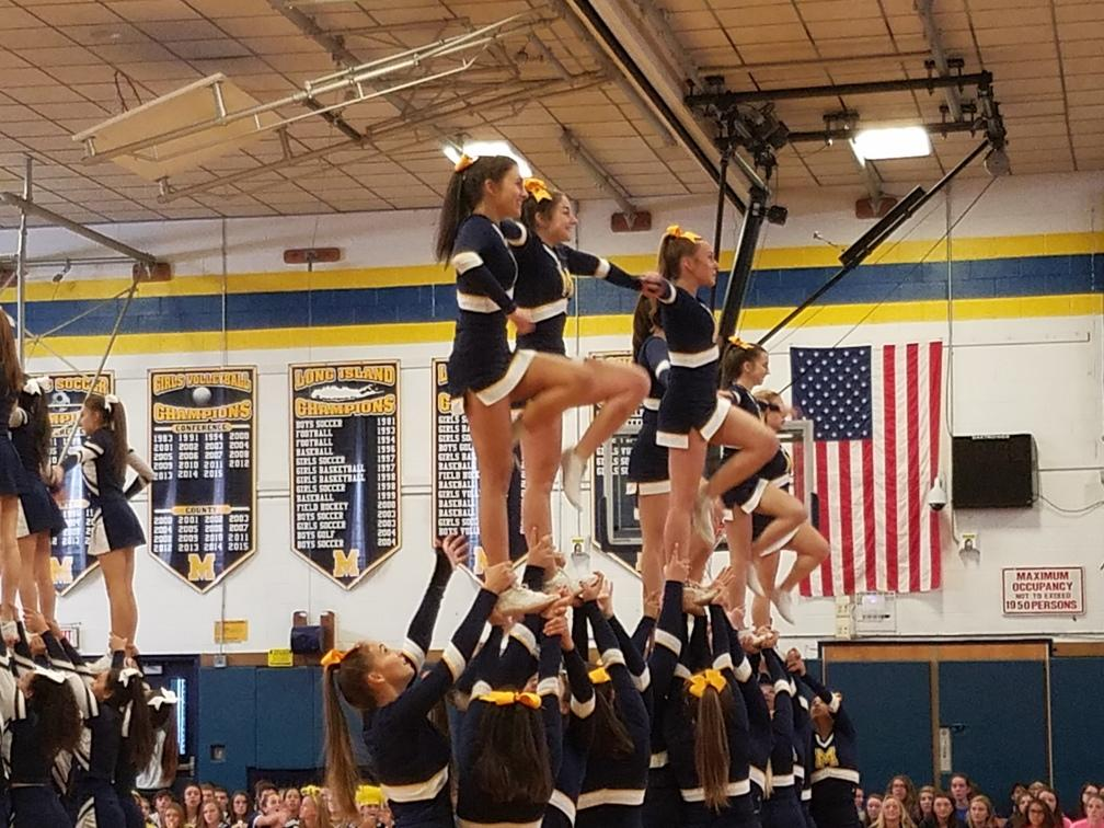 The varsity cheerleading team performed excellently at this year's pep rally.