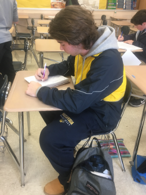 AP student and athlete, Luke Weiss, studying in his AP World History class.