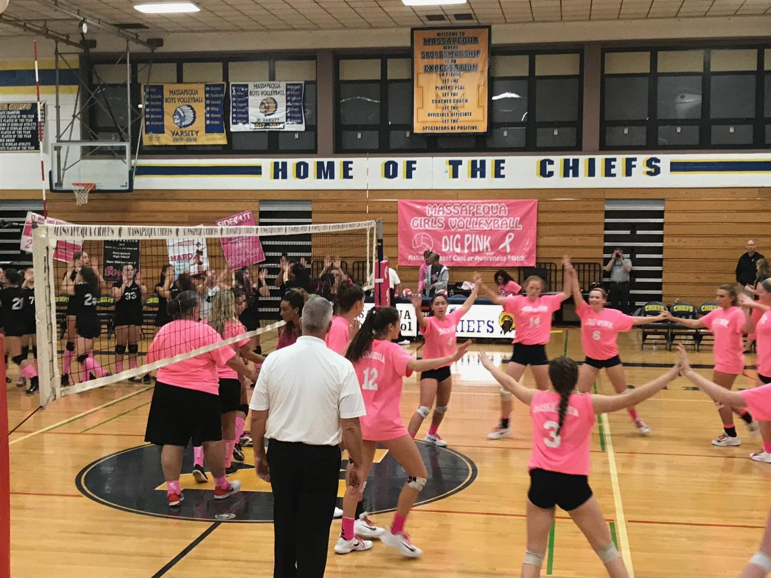 The girls volleyball team spiking to victory!